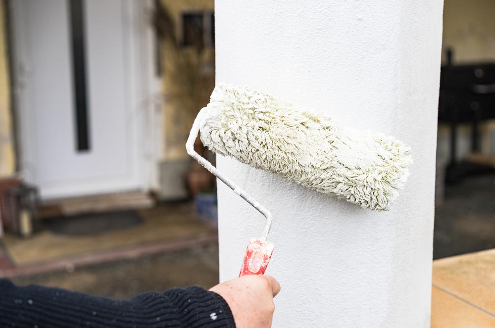 Fasadmålning målar pelare